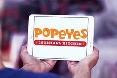 Logotipo del restaurante de los alimentos de preparación rápida de Popeyes Imagenes de archivo