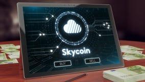 Logotipo do cryptocurrency de Skycoin na exposição da tabuleta do PC ilustração 3D imagens de stock