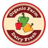 Logotipo fresco y orgánico de una lechería redonda de la granja con paprikas stock de ilustración