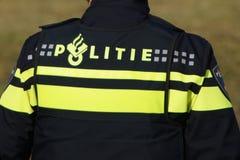 Logotipo holandês do uniforme do agente da polícia Foto de Stock