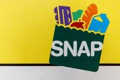 Logotipo RÁPIDO La BROCHE ofrece ayuda de la nutrición a los individuos y a las familias elegibles VI foto de archivo