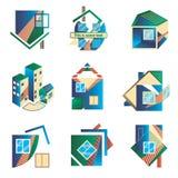 Logotipos coloreados bajo la forma de casas Foto de archivo