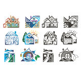Logotipos coloreados bajo la forma de casas imagenes de archivo