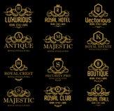 Logotipos de oro reales lujosos heráldicos imagen de archivo libre de regalías