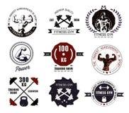 Logotipos y emblemas del gimnasio del levantamiento de pesas y de la aptitud Imagen de archivo libre de regalías
