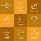 Logos with honey. Logotype collection with honey, honeycomb, honeybee, flowers, dipper with honey. Eco product label Stock Image