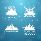 Logotype ski, mounrain and snow patrol with mounrain rescue Stock Photos