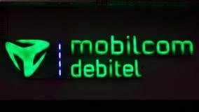 Logotype verde illuminato del debitel del mobilcom fotografie stock libere da diritti