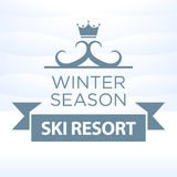 Logotype winter season ski resort on snow background. And crown Royalty Free Stock Photo