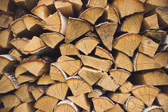 Logs of birch firewood. Pile of firewood stacked on top of each other Stock Image