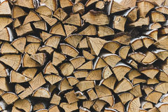 Logs of birch firewood. Pile of firewood stacked on top of each other Royalty Free Stock Image