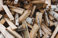 Logs of birch firewood. Pile of firewood stacked on top of each other Royalty Free Stock Photography