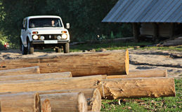 Logs (blockhouse) and car Stock Photos