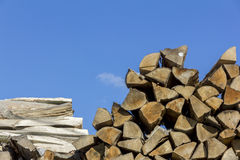 Logs of and boards of wood of different shapes, sizes and kinds Stock Photos