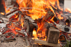 Logs and branches burning in a wood fire Stock Photos
