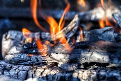 Logs burn with a bright flame Stock Images