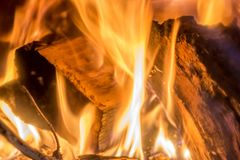 Logs burn in the fireplace in a romantic fire stock photos