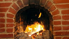 Logs burning in brick fireplace stock video footage