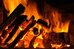 Logs burning on fire. Closeup of logs burning on fire at night Royalty Free Stock Photography