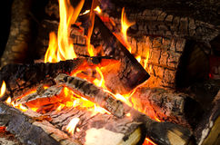 Logs burning on fire. Closeup of multiple logs, burning on fire Royalty Free Stock Photos