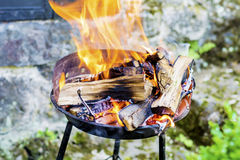 Logs Burning in a Fire Pit- big golden flames Stock Photo