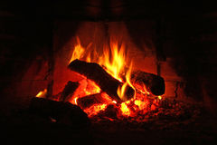 Logs burning in fireplace. Closeup of logs burning in fireplace Royalty Free Stock Images