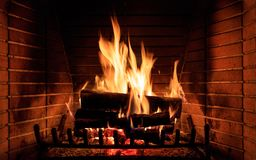 Logs burning in a fireplace. Close up of burning fireplace at home stock image