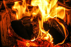 Logs burning hot in fire place. Stock Photography