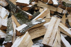 Logs. Chopped logs lie on the street during the winter Royalty Free Stock Images