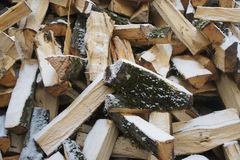 Logs. Chopped logs lie on the street during the winter Royalty Free Stock Image