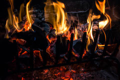 Logs and coal on fire Stock Photos