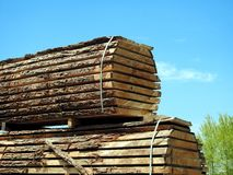 Logs cut into planks. A lumber yard with logs cut into planks drying in the sun Stock Photography