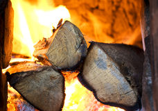 Logs on fire. Inside a traditional fire place stock images