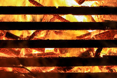 Logs in fire. Big huge traditional fire blaze glow. Background Stock Photos