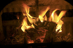 Logs on fire in grate. Wood logs burning in grate stock images