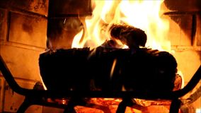 Embers and flame. Logs in a fireplace burning stock video
