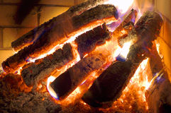 Logs in fireplace. Stock Photos
