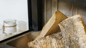 Logs in fireplace stock photography