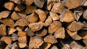 Logs of firewood neatly layered in the woodpile stock footage
