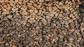 Logs of firewood neatly stacked in the woodpile in winter stock video