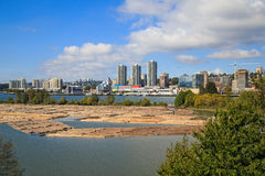 Logs in the port with cityscape in the background Royalty Free Stock Photos
