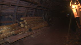 Logs in the shaft passage to strengthen the walls stock footage