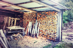 Logs storage in old barn Stock Photos