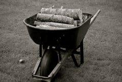 Logs In A Wheelbarrow Royalty Free Stock Photography