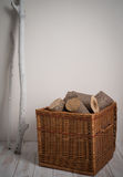 Logs In Wicker Basket with driftwood Royalty Free Stock Images