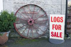 Logs wood for sale sign at farm shop for biomass burner. Uk stock photography