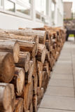 Logs woodpile near modern building house wall Stock Photo