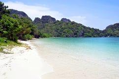 Loh Lana bay at Phi Phi island. Loh Lana bay, or Ao Loh Lana, at high tide at Koh Phi Phi Don, Andaman Sea, Krabi province, Thailand Royalty Free Stock Images