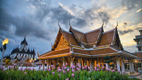 Loha Prasat and Wat Ratchanadda Temples at sunset Stock Images