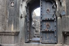 Ancient gate of wood and metal stock photography